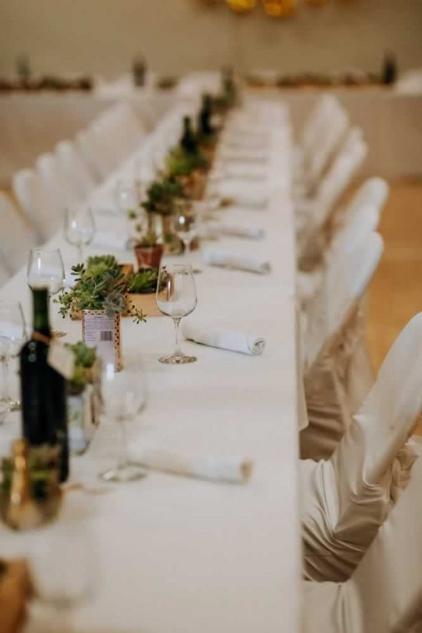 long table set for wedding reception